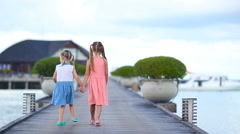 Adorable little girls during summer vacation in the evening - stock footage