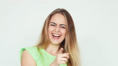 Teenager 18 years old laughing at camera on white background Stock Footage