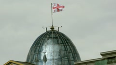 Georgian flag fluttering over the glass dome of the presidential residence - stock footage