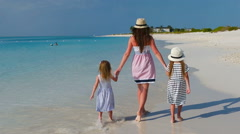 Happy beautiful family on a tropical beach vacation Stock Footage