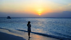 Young beautiful woman enjoying beach tropical vacation Stock Footage