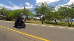 Female in black leather jacket and helmet on sport bike Stock Footage