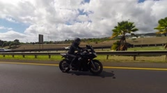 Female in black leather jacket and helmet on sport bike Stock Footage