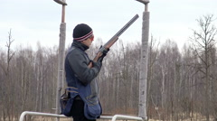 The young shooter shoots targets in a sports club outside. Sport shooting. Stock Footage