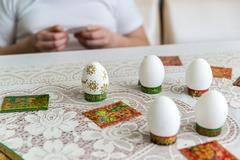 Boy decorate eggs for Easter with stickers - stock photo