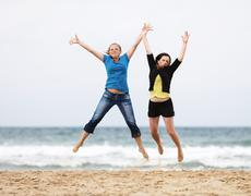 Young women jump - stock photo