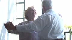 Active retirement and leisure activities, happy dance of an elderly couple - stock footage
