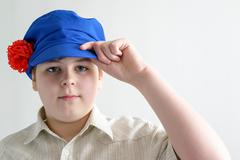 Portrait of boy teenager in Russian national cap with cloves - stock photo