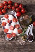 Mozzarella, cherry tomatoes and fresh basil - ingredients for caprese salad Stock Photos