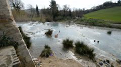 Tourists bathing in natural thermal springs in Saturnia, Italy. Stock Footage