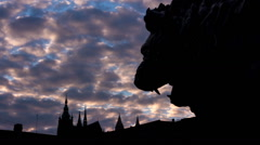 Silhouette of a lion statue in front of the Prague castle time lapse HD Stock Footage