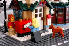 Lego post office. Woman with letter near post boxes. Stock Photos