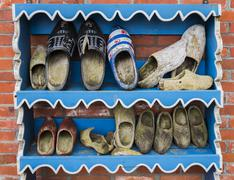 Wooden Shoes on Rack in Wierum Stock Photos