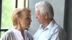 loving and happy elderly couple in a modern apartment. they talk, smile and - stock footage