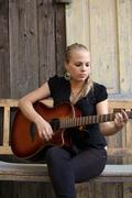 Acoustic guitar player Stock Photos