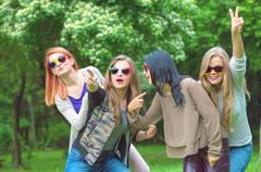 Happy friends posing together on  summer day Stock Photos