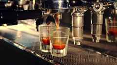 Professional espresso machine brewing a coffee in bar. Coffee pouring into shot Stock Footage