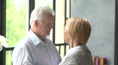 loving and happy elderly couple in a modern apartment. they talk and smile - stock footage