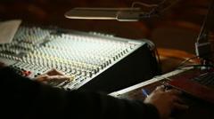 Professional's Hand Working On Audio Mixer In Studio Stock Footage