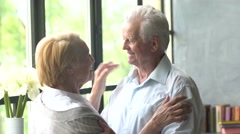 loving elderly couple. husband is experiencing, bad news. try cheer up wife and - stock footage