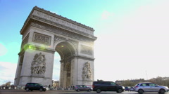 Major tourist attraction in Paris, Triumphal Arch against blue sky background - stock footage