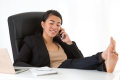 Amused and relaxed asian businesswoman - stock photo