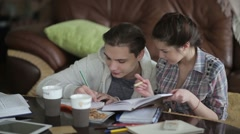 Male student is writing the task. - stock footage
