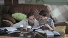 Couple of students studies the subject. - stock footage