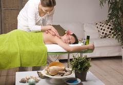 stock photo attractive lady getting spa treatment in salon, massage doctor - stock photo