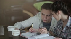 The student writes a mathematical example. - stock footage