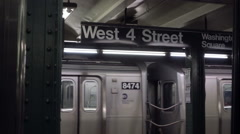 Zooming out from West 4th St subway station sign in NYC Stock Footage