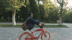 Young woman riding vintage bike in park and having some fun, slow motion Stock Footage