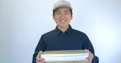 Japanese delivery man ok sign with package white background  - stock footage