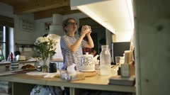 Man and woman in the kitchen, preparing drinks, normal day Stock Footage