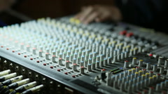 Professional's Hand Working On Audio Mixer In Studio Stock Footage