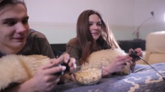 Pair of students playing video game at home. Stock Footage