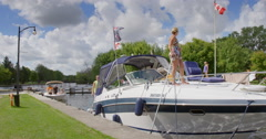 Woman Standing On Boat Docked At Ottawa Locks Stock Footage