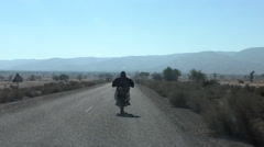 Man riding motorcycle in countryside of Morocco Stock Footage