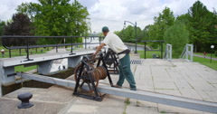 Man Cranking Closed A Gate Of The Ottawa Locks Stock Footage