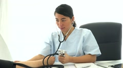 Asian doctor measuring blood pressure Stock Footage