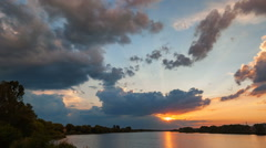 Sunset with rain over the lake. Time Lapse Stock Footage