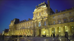 Louvre Museum territory crowded by many tourists viewing palace and pyramids - stock footage