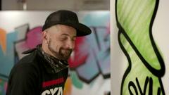 Graffiti artist spray painting at studio. Stock Footage