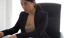 Concentrated asian girl working at computer Stock Footage