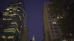 Driving through the city at night. high rise buildings Stock Footage