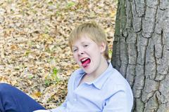 Cute boy with put out tongue Stock Photos