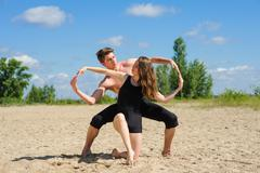 Man and woman hands showing infinity symbol - stock photo