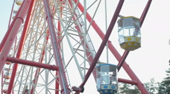 Giant ferris wheel against blue sky and white cloud which mean an amusement-park - stock footage