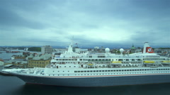 Hurrying clouds over Stavanger and large cruise ship Stock Footage