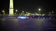 Crowd of pedestrians crossing street, leaving Place de la Concorde, night Paris - stock footage